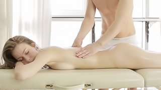 Relaxed and aroused lady on the massage table fucked hard