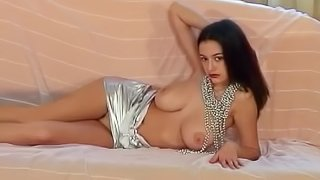 Fancy sex doll in a sexy outfit flaunting her big tits solo