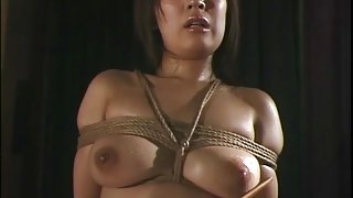 Wet Japanese girl tied up by rope