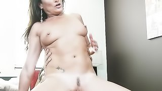 Gaudy, brunette MILF fucks her trimmed, pink pussy with sex toy before riding guy's hard dick.