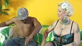 Tattooed cowgirl being nailed in an interracial sex