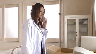 Wild nurse Rina Fujimoto sets up a camera and films herself fingering her own pussy
