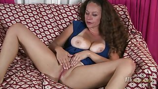 Milf teases her amazing cleavage and rubs her pussy
