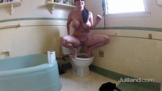 Sophie Dee Pissing Into a Toilet