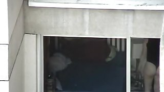 Opened window allows us voyeur babes ass in thong