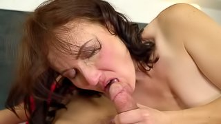 Seductive mature beauty lures a young man into her bed