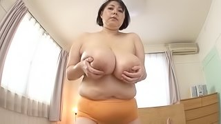 Mature Japanese MILF having her massive tits oiled before squeezing them seductively in POV