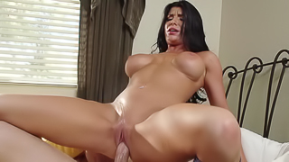 Raven haired babe with big boobs rides a handsome XXX stallion