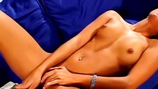 Cute chick with nice face is playing with tanned puss
