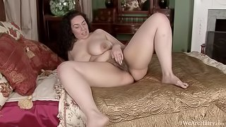 Anastasia Lux strips naked and is sexy on bed
