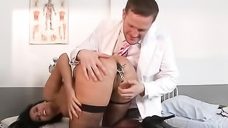 Lewd lass in dark stockings gives her ass to a medical professional in a treatment room.