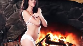 Passionate solo action from busty brunette beauty at the fireplace