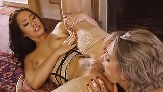 Two girls show each other care and love with a large dildo