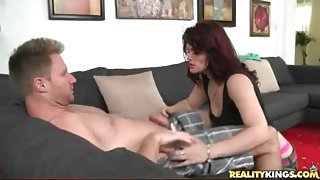 Cougar gets on her knees and sucks his cock lustily
