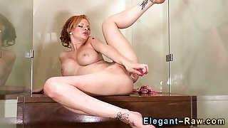 Classy redhead toys ass and rubs cunt