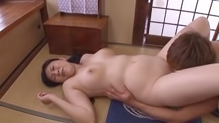 Chubby Japanese milf enjoys doggystyle sex after giving a blowjob