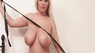 Shiny black tape over tits of busty babe