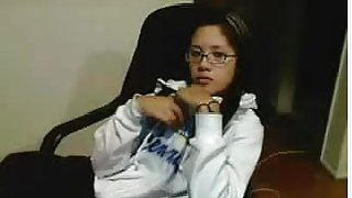 Amateur Asian teen with glasses fingers herself on cams