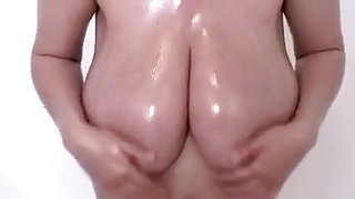 My busty pregnant wife oils her body in homemade solo clip