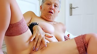 Busty mature lady seductive striptease and solo action video