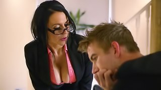 Huge titted brunette with glasses and nylons rides cock on couch