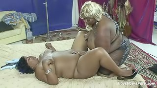 Two fat babes are licking each other passionately