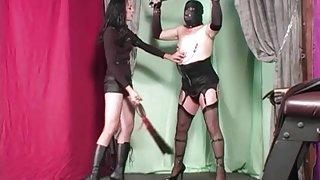 Dominatrix punishing and whipping her sissy