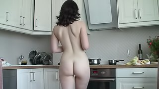 Brunette beauty does some kitchen work naked