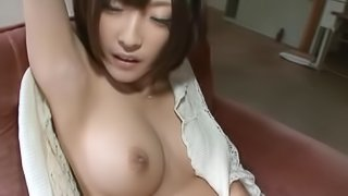 Naughty and horny Japanese babe Rei Aimi is showing her tits
