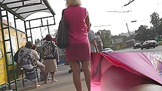 Golden-Haired in pink costume very sexy upskirt