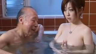 Pretty Japanese girl sucks some old man's cock in the bathroom