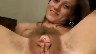Chick Spreads Her Very Hairy Pussy and Meaty Labia