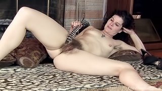 Sunshine strips and teases her body with a feather