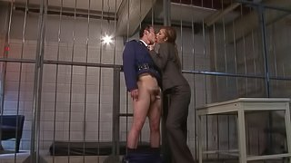 A prison guard gets fucked by his sexy female boss in a cell