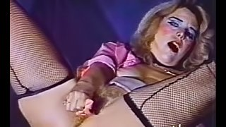 Tantalizing pornstar in fishnet stockings fingers her pussy before giving a blowjob