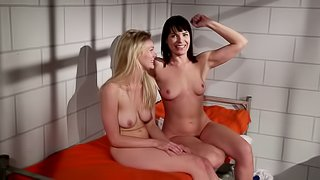 Girls locked in a prison cell get naked and play with each other