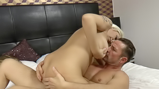 A stunning babe gets her boobs pushed together for tits fucking
