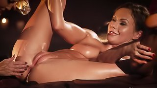 Two stunning babes are covered in oil and engaged in sensual sex