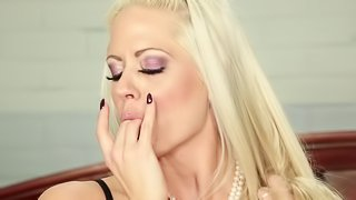 Seductive blonde is deeply penetrated by a big black cock