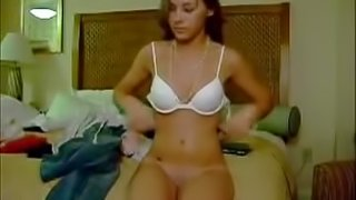 Cute Euro slut undresses and fingers her pussy