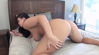 Busty Alison Tyler puts a glass toy in her wet pussy