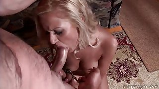 Cuffed slut in nipple clamp gives a BJ