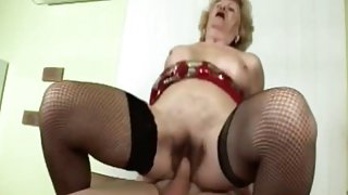 Busty granny gets filled with stiff rod