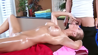 A sexy woman that has large tits gets a fine massage today