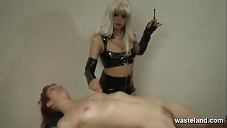 Lesbian Dominatrix covers her slave in hot wax and finger fucks her pussy