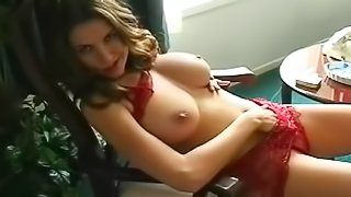 Horny beauty teases with her boobs