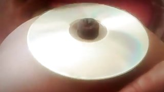 chubby girl bellybutton stuffing into a cd