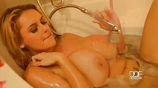 Babe in a candlelit bath plays with her pussy