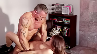 A babe with a nice rack is getting her wet pussy licked in front of the fire