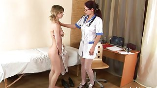 beautiful babe gets seduced by pervert nurse who fucks her with a strapon
